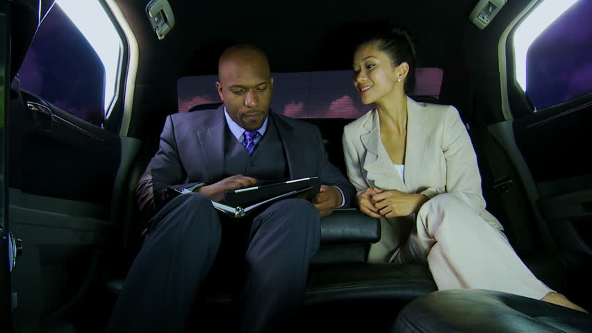 Male female multi ethnic company executives travelling important business meeting by luxury limousine meet and greet service | Shutterstock HD Video #1023271711