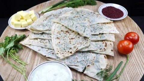 Turkish cuisine. Traditional Turkish gozleme. 4K