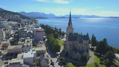 Aerial view of the town of Bariloche with Cathedral of Our Lady of Nahuel Huapi and the lake of Nahuel Huapi. Patagonia, Argentina