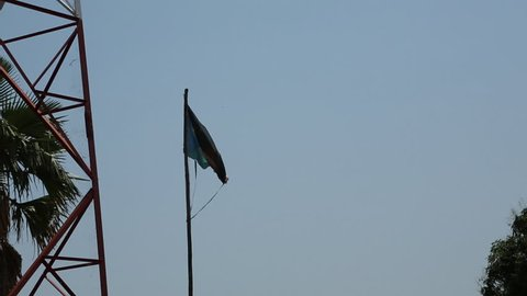Torn South Sudan Flag Blowing In Wind