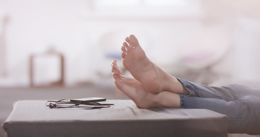Young attractive female listening to music in the living room | Shutterstock HD Video #1023582511