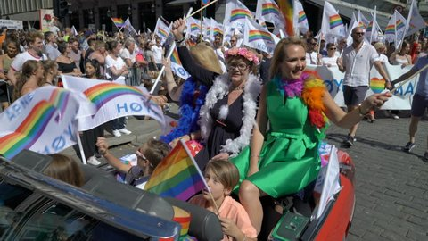 OSLO, NORWAY - JUNE 30, 2018: Huge costume crowd sings and dances. The Pride Parade, the highlight of Oslo's Pride Week, is a huge, vibrant parade filling the city's streets.