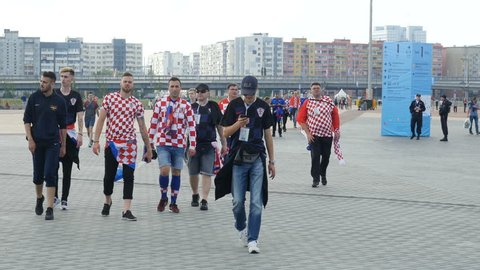 Kaliningrad, Russia, July 2018 - Fans walk to stadium for a game, soccer spectators crowd walks to the stadium. Croatian fans walk to stadium for a game, soccer spectators crowd walks to the stadium
