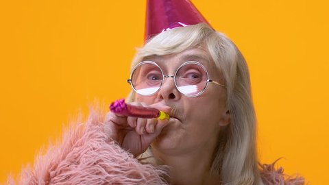 Funny mature woman party hat blowing noisemaker, celebrating festival, animator
