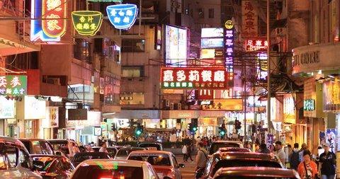 Hong Kong, China 4 SEP 2018: Neon shop signs and emblems at night on Hong Kong street