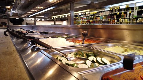 Fulham, london - january 8, 2018: hot food buffet in the self service  section of whole foods market in fulham, west london, uk