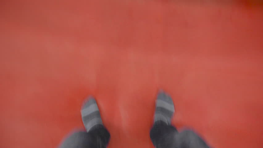 First Person view of man is jumping on a trampoline | Shutterstock HD Video #1023915331