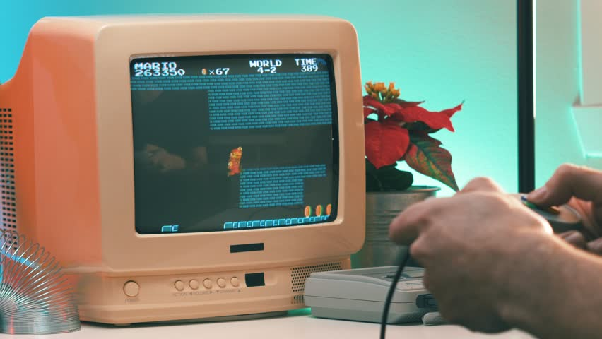 MONTREAL, CANADA - February 2019 :   Playing a retro Mario bros video game on TV 80's 90's style. Retro looking desk and setup with old television CRT monitor. | Shutterstock HD Video #1024033931