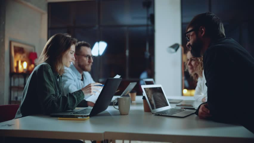 Team of young coworkers work together at night office | Shutterstock HD Video #1024047521