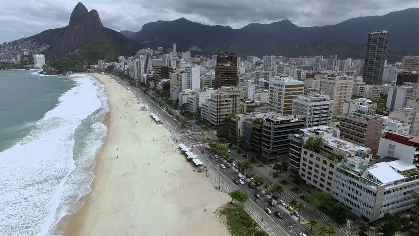 Leblon Beach and Vidigal slum in the background, Rio de Janeiro Brazil. Cloudy day. Without sun.  | Shutterstock HD Video #1024142381