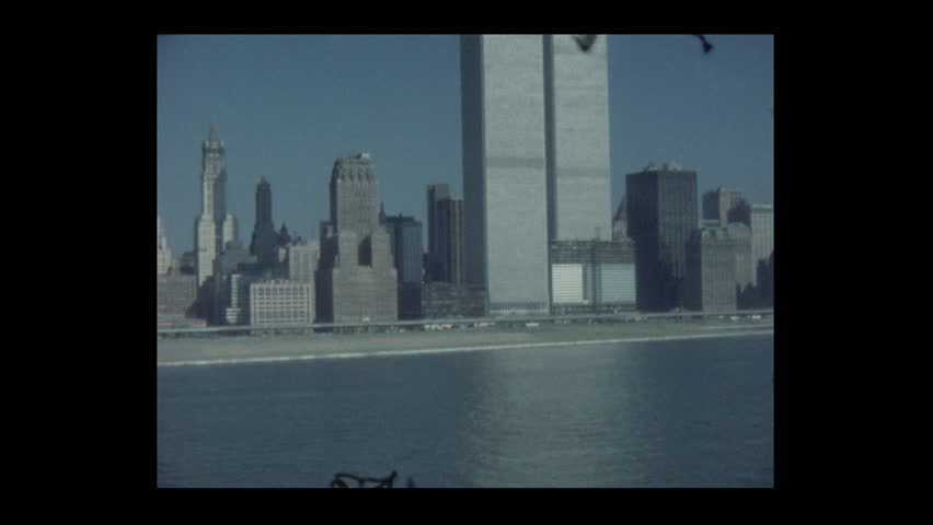 New York, New York, USA- 1980: QE2 Sail away Sailing past the World Trade Center