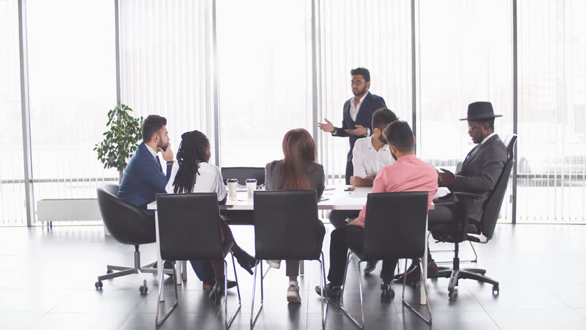 Indian awesome man is showing his plan to colleagues. successful businessmen giving advice to new employees | Shutterstock HD Video #1024208501
