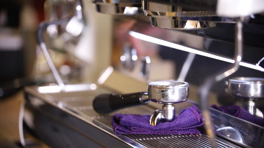 Barista making coffee. Cleaning holders | Shutterstock HD Video #1024303631