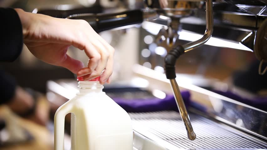 Barista making coffee. Opening a canister with milk | Shutterstock HD Video #1024303691