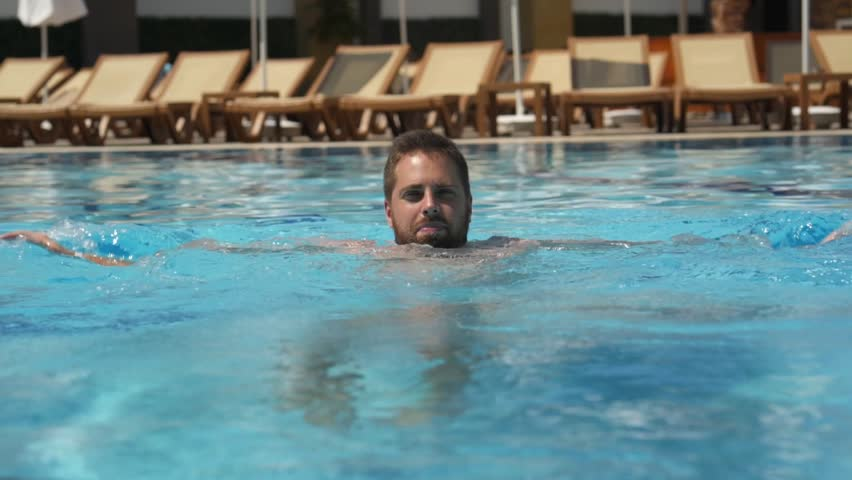 Young man resting in the pool. The rest in the hotel is all inclusive. Summer rest #1024341611