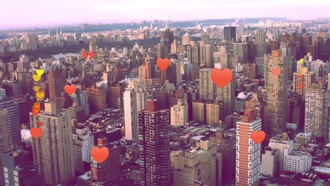 Heart emoji icons flying upwards from buildings into sky, dating app. For social media, global digital connections, networking, emojis, communication, digital media platforms. New York 4k RED.
