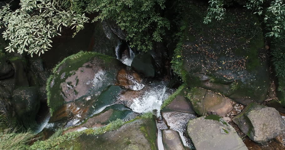 Aerial above view through trees of a stream flowing in the mountain valley, 4k nature landscape travel drone footage    Shutterstock HD Video #1024383041