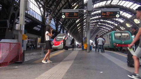 MILAN, ITALY - circa May 2018: People walking in Central station in Milan, Italy, interior view. Every day about 320,000 passengers pass through the station, slow motion