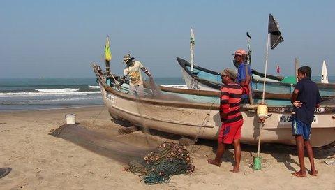 Arambol, Goa, India - Circa February, 2019. Fishermen on the Arambol beach.
