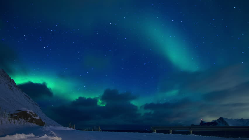 Clouds and northern lights in the night sky of | Shutterstock HD Video #1024567331