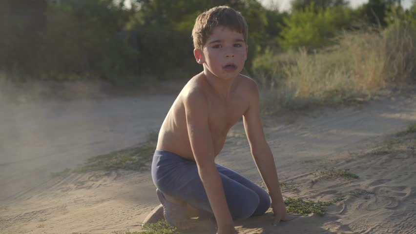 Hy Child Is Lying In The Steppe Dust