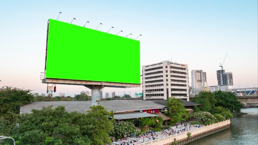 Green screen of advertising billboard on restaurants near river of twilight in Bangkok, Thailand. time lapse.   Shutterstock HD Video #1024626641