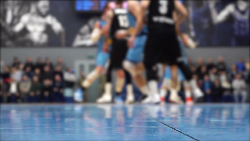 Basketball game video shooting below,  players out of focus | Shutterstock HD Video #1024696601