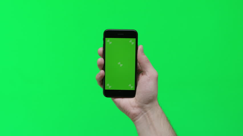 Male hand holding smart device on green screen chroma background making gestures, zoom in, pinch, swipe, scroll | Shutterstock HD Video #1024737671