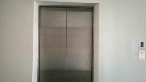 The elevator door is closing without people