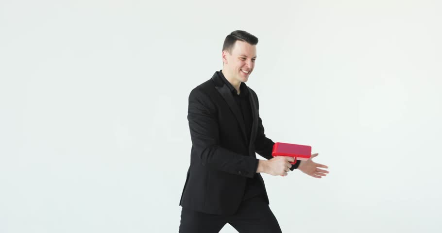 Man in suit throwing money. Successful business or winning the lottery. cash cannon money gun. Slow motion | Shutterstock HD Video #1024794461