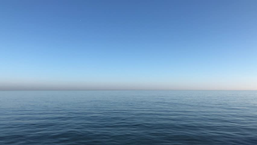 Video of calming waves of the North Sea/Ocean during a warm sunny morning with a blue cloudless sky at Roker Pier, Sunderland, Tyne and Wear, England UK. | Shutterstock HD Video #1024828091