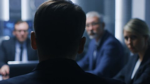 On the Business Meeting Chief Analytics Makes Report, CEO and Top Managers Listening. Meeting in the Conference Room.