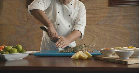 Chef cut up sharp knife large lobster. 4K slow motion video