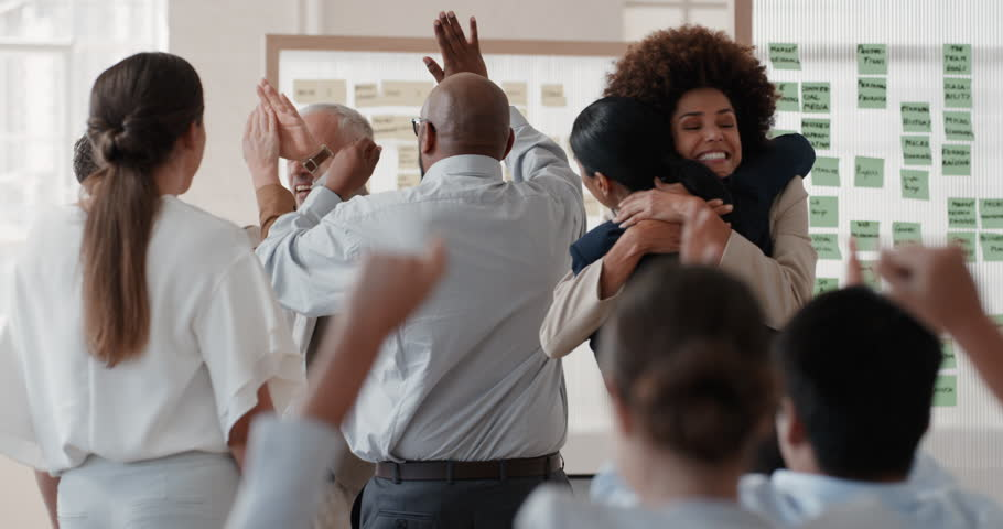 Happy business people celebrating successful corporate victory colleagues high five in office meeting enjoying winning success | Shutterstock HD Video #1025001761