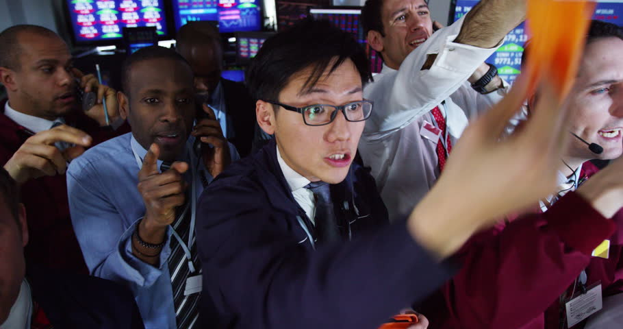 4k Diverse Group Of Stockmarket Traders Frantically Buying