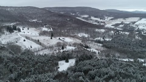 4K aerial flying over a beautiful, snow covered winter rural landscape in upstate New York