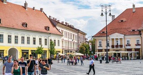 SIBIU, ROMANIA - 21 JULY, 2018: 4k Timelapse of people walking in the big square in Sibiu, Romania