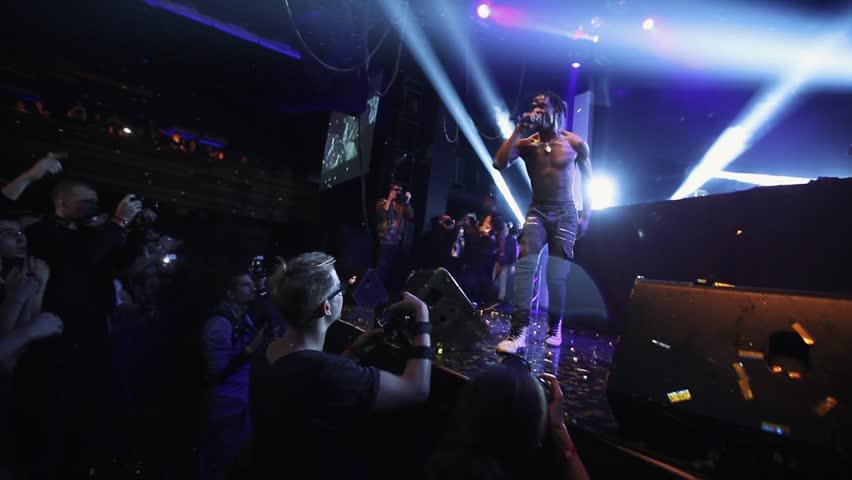 MOSCOW-6 DECEMBER,2014:Concert of rap singer Travis Scott,Kylie Jenner partner.Group of hip hop fans party on festival in music hall.Presentation of Owl Pharaoh album,song Upper Echelon in nightclub