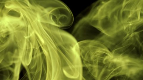 Thin trickle of bright neon yellow smoke slowly rising graceful twists up on black background. Colored smoke blowing from bottom to top.