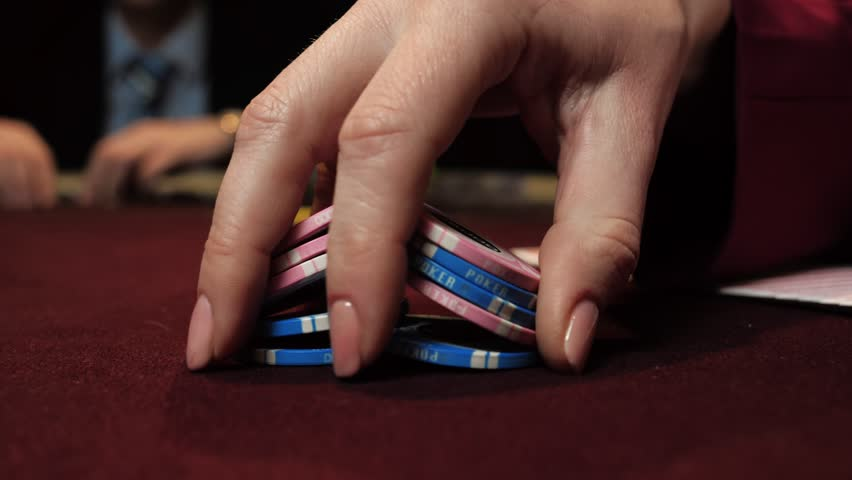 Casino: dealer shuffles the poker chips and performing trick with chips use one hand. Hand close-up. | Shutterstock HD Video #1025531231