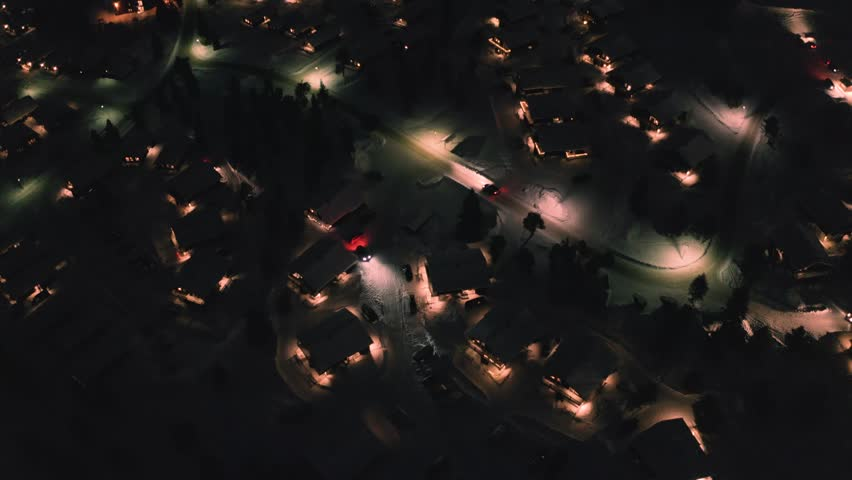 AERIAL: view over ski town at night. Sweden, Sälen. | Shutterstock HD Video #1025533601