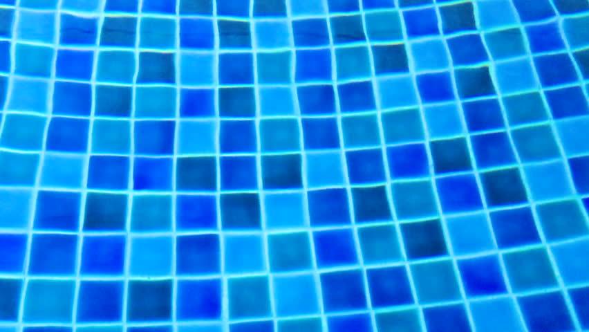 Abstract water ripples on different of blue tiled swimming pool background. | Shutterstock HD Video #1025624291