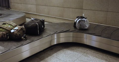 Baggage claim at the airport. Suitcases During Transportation On Claim Conveyor In The International Airport