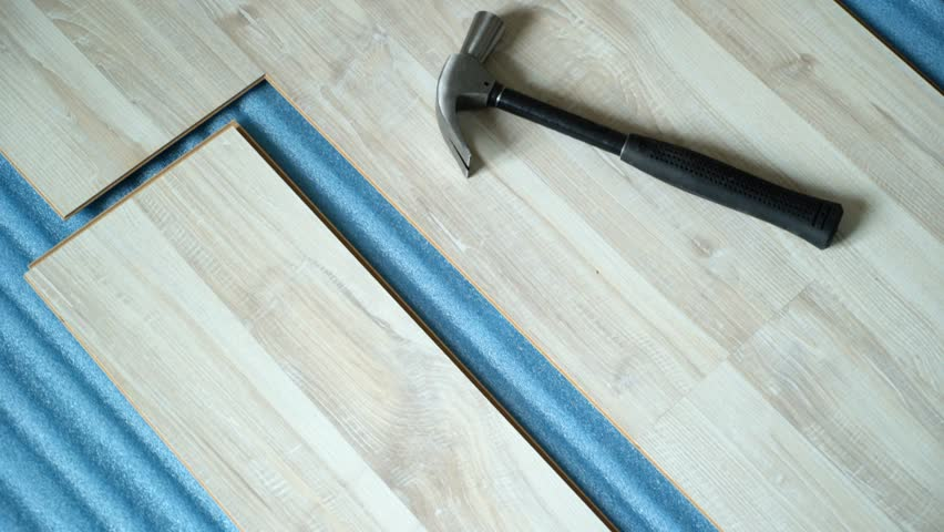 Repair of the apartment, laying laminate flooring. Construction | Shutterstock HD Video #1025655851