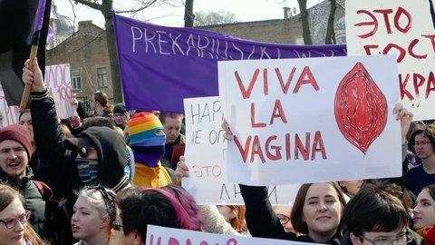 Kyiv, Ukraine - March, 2019: Girl holds sign viva la vagina at women's march in Kiev