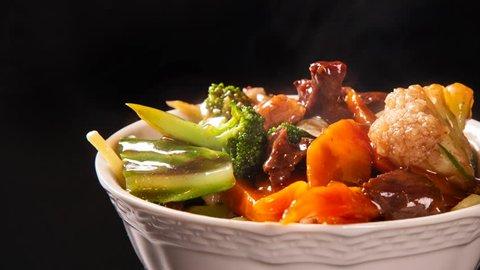 Slide shot Japanese food. meet and vegetables with smoke. Yakisoba with smoke.