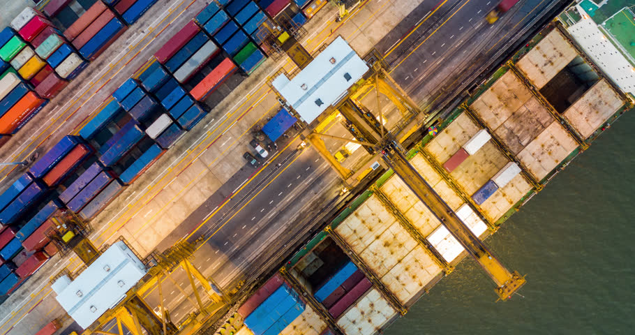 Hyperlapse Top view of international port with Crane loading containers in import export business logistics. | Shutterstock HD Video #1025717381