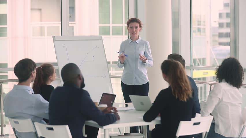 Diverse employees and female coach mentor raise hands at corporate business training workshop get engaged involved in voting volunteer participate in team office presentation support unanimous idea | Shutterstock HD Video #1025732681