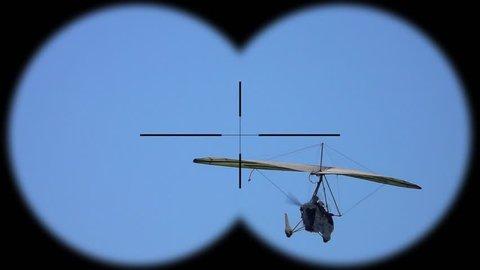 Flying Deltaplan Seen through Binoculars. Active Hobbi and Sport