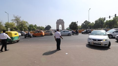 A traffic cop helps a driver to find his way where traffic is moving smoothly near India Gate circle during a busy working day at India Gate, New Delhi, India on 15 march 2019.